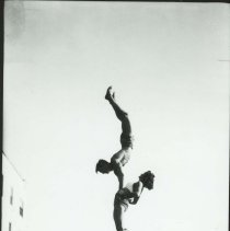 Image of A Three-High Acrobatic Stunt at Muscle Beach - mid 1900s
