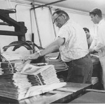 "Image of Pressmen Bundling Copies of ""The Outlook"" - undated"