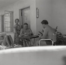 Image of Friends Enjoy a Poolside Card Game, 1950 - 1950/10/06