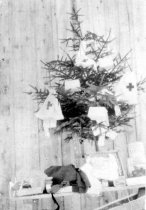 Image of Small Christmas tree decorated with American Red Cross bag
