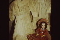 Image of Children's clothing & bisque doll