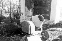Image of HL106 - Close up of cement mixer and foundation hole 1962