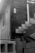 Image of HL109 - Close up of Floor Joist  and cinder block wall1962