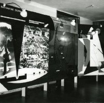 Image of Health exhibits from Colone, Germany from the 1930's. Photos of what appear to be traveiling display panels on diseases, diagnostics, radioactivity and hormones and vitamins. Viewers present in some photos; all black and white.