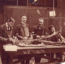 Image of Four men with one cadaver.