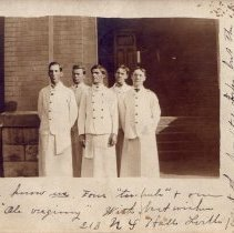 Image of Five students in lab coats.