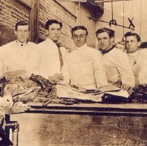 Image of Seven men with one cadaver.