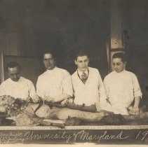 Image of Four men with a cadaver Inscription on back: Dissecting room Strs. of Mercy Hospital University of Maryland 1924-1925