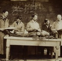 Image of Four students and Dr.  H. L. Barnes with a cadaver