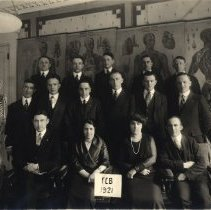Image of Class photo with skeleton and anitomical model, anatomical posters in background.