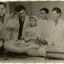 Image of 4 men and a woman with dissected cadaver. This photograpgh has been manipulated, the person on the far left and the cadavers heads have been replaced.