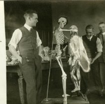 "Image of Four men with skeleton, ""dancing"" with anatomical model. 