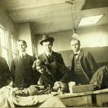 Image of Four men with dissected cadaver.