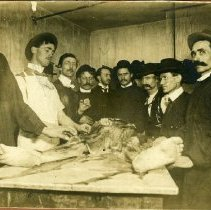 Image of Group of men with dissected cadaver. Back reads: pop- Howard Leslie Cornell, Sr. in  medical school, Kansas City MO. (about 1903)