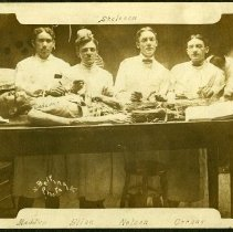 Image of Four men with dissected cadaver.  Last names written on photo; Maddox, Bline, Nelson, Cornet.