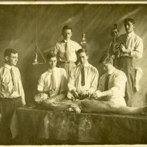 Image of Six men with dissected cadaver and skeleton.
