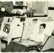 Image of Iron Lung- Drinker Model - These photographs show iron lungs which appear to be modeled after the design created by Dr. Philip Drinker in the late 1920s.