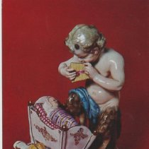 Image of Faun playing pan-pipe to child in cradle