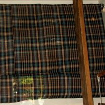Image of hand woven plaid cloth
