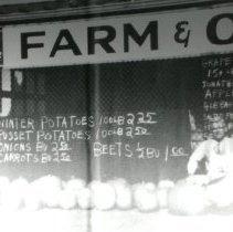 Image of P2009.016.023 - Henry Hoffman in front of Hoffman's Market