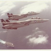 Image of Two F-14 Tomcats from VF-51 over USS Kitty Hawk, CV-63) - Photograph