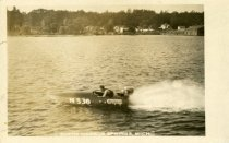 Image of Man in small boat on lake in Harbor Springs
