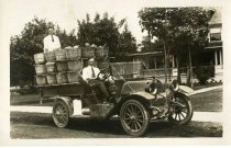 Image of Two men in automobile carrying baskets