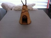 Image of Birch bark teepee with quillwork ties.