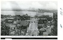 Image of Harbor Springs from the bluff with a steamship in the harbor.