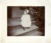 Image of Abigail Shay on grandmother Roe's steps.  (2.5 years?)