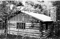 Image of Photograph of a log cabin.