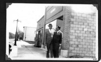 Image of Two men standing outside of the Graphic building.