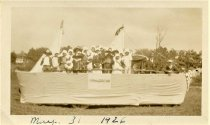 "Image of Folder 62 - Group of people on ""Sand Brook"" parade float, May 1926"
