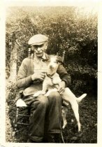 Image of Folder 32 - Henry K. Fink, sitting with dog