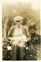 Image of Folder 33 - Henry K. Fink, sitting with cat