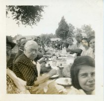 "Image of Folder 236; ""Miss Bell Lare"" and others at an outdoor meal (Robbins), n.d."