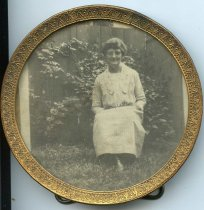 Image of Folder 237; framed portrait of woman in garden (Klett), n.d.