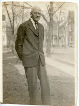 Image of Folder 242; unknown man in suit standing next to street (Klett), n.d.