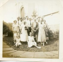 Image of Folder 218; Group image of family outside a church, 8/11/1934