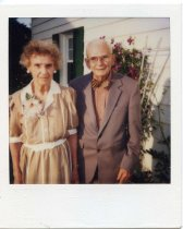 Image of Folder 250:  Catharine and Guy Klett outside a home by a rose trellis, n.d.