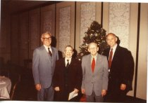 Image of Folder 254:  Guy Klett and three unidentified men by a  Christmas Tree n.d.