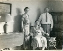 Image of Folder 222; Three unknown family members in a living room, 9/17/1941