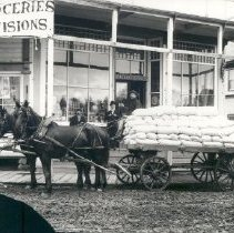 Image of Negative, Glass-plate - Horses and loaded cart outside of Henderson's Store