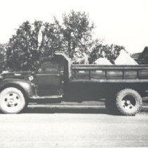 Image of Print, Photographic - Truck loaded with rocks for dyke building