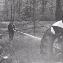 Image of Print, Photographic - Public Works spraying roadside bushes and grasses