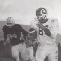 Image of Print, Photographic - Two football players, one of each team running with the ball