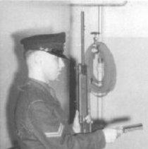 Image of Print, Photographic - Cpl. D.J. MacGregor, teaching at Militia Survival Course