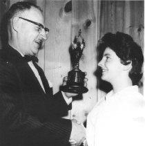 Image of Print, Photographic - D.L. Elderkin present 4-H trophy to Donna Kickbush