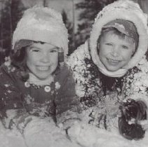 Image of Print, Photographic - Sharon Redman and Doug Lamb playing in the snow