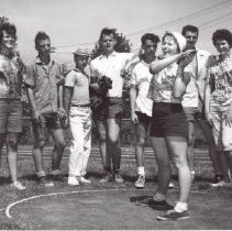 Image of Print, Photographic - Junior Olympic Training Program a group of young people standing behind a girl ready to thro a Discus